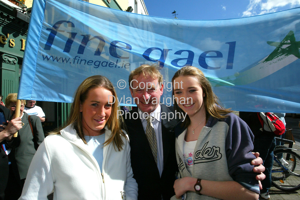 8/5/2004.Enda Kenny leader of Fine Gael pictured recently during his visit to Kilkenny as part of his European and Local Election Campaign Trail .Pictured during the visit was Maria Connolly (left) and Claire Teehan both from Kilkenny with Enda Kenny leader of Fine Gael..Picture Dylan Vaughan