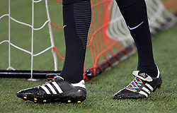 A referee with rainbow laces on his boots