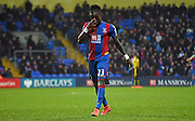Pape Souare hangs his head after being sent off during the Barclays Premier League match between Crystal Palace and Watford at Selhurst Park, London, England on 13 February 2016. Photo by Michael Hulf.
