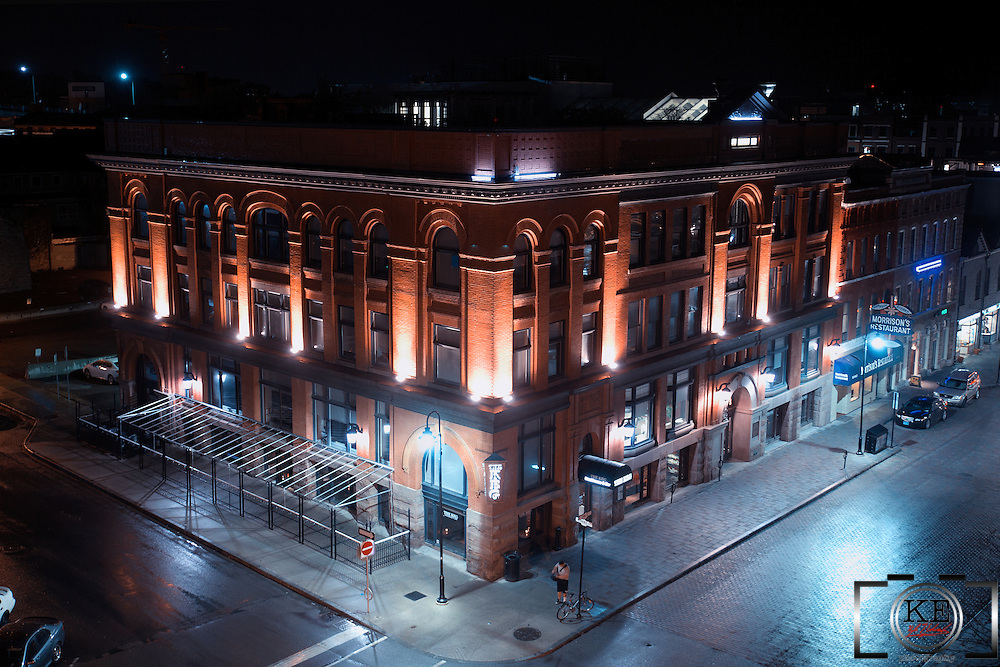 An overhead photograph of a corner brick building, with second floor lighting making for a very nice effect.  It's actually The Keg, but Morrison's Restaurant is right next to it.