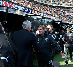 NEWCASTLE-UPON-TYNE, ENGLAND - Sunday, April 1, 2012: Newcastle United's manager Alan Pardew and Liverpool's manager Kenny Dalglish before the Premiership match at St James' Park. (Pic by Vegard Grott/Propaganda)