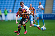 Bradford City forward Alex Jones (19) is fouled by Coventry City defender Chris Stokes (3)  during the EFL Sky Bet League 1 match between Coventry City and Bradford City at the Ricoh Arena, Coventry, England on 11 March 2017. Photo by Simon Davies.