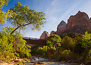 The bridge over the Virgin River in Zion National Park, Utah. From left to right the peaks are Mountain of the Sun, Twin Brothers, and The East Temple.