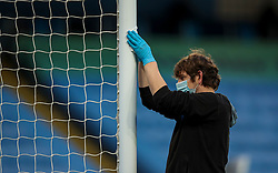 MANCHESTER, ENGLAND - Thursday, July 2, 2020: Groundstaff disinfect the goal post during the FA Premier League match between Manchester City FC and Liverpool FC at the City of Manchester Stadium. The game was played behind closed doors due to the UK government's social distancing laws during the Coronavirus COVID-19 Pandemic. This was Liverpool's first game as Premier League 2019/20 Champions. (Pic by Propaganda)