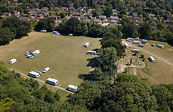 © Licensed to London News Pictures. 29/06/2018. Fetcham, UK. Traveller caravans and other vehicles occupy a football field and children's play area at Fetcham Recreation ground. The site was occupied by 18 vehicles on Wednesday 27th June and the occupants were issued with a Notice of Direction requesting that they leave by Mole Valley District Council. This has been ignored and the council went to court to seek further legal action yesterday (28th June 2018). Photo credit: London News Pictures