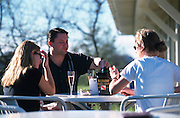 Enjoying the famous Mumm champagne at the company vineyard in Napa Valley, California.