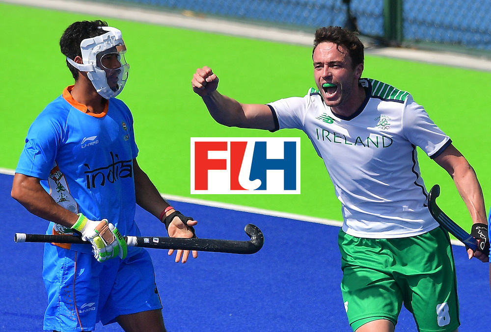 Ireland's Chris Cargo (R) celebrates scoring a goal during the men's field hockey India vs Ireland match of the Rio 2016 Olympics Games at the Olympic Hockey Centre in Rio de Janeiro on August, 6 2016. / AFP / Carl DE SOUZA        (Photo credit should read CARL DE SOUZA/AFP/Getty Images)