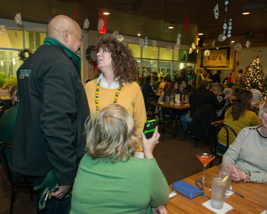 December 5, 2015 - Fairfax, VA - A day in the life of &quot;Doc Nix,&quot; aka Dr. Michael Nickens, the Director of the Athletic Bands for George Mason University. Here with girlfriend Lauren Wagner at Brion's <br /> <br /> Photo by Susana Raab