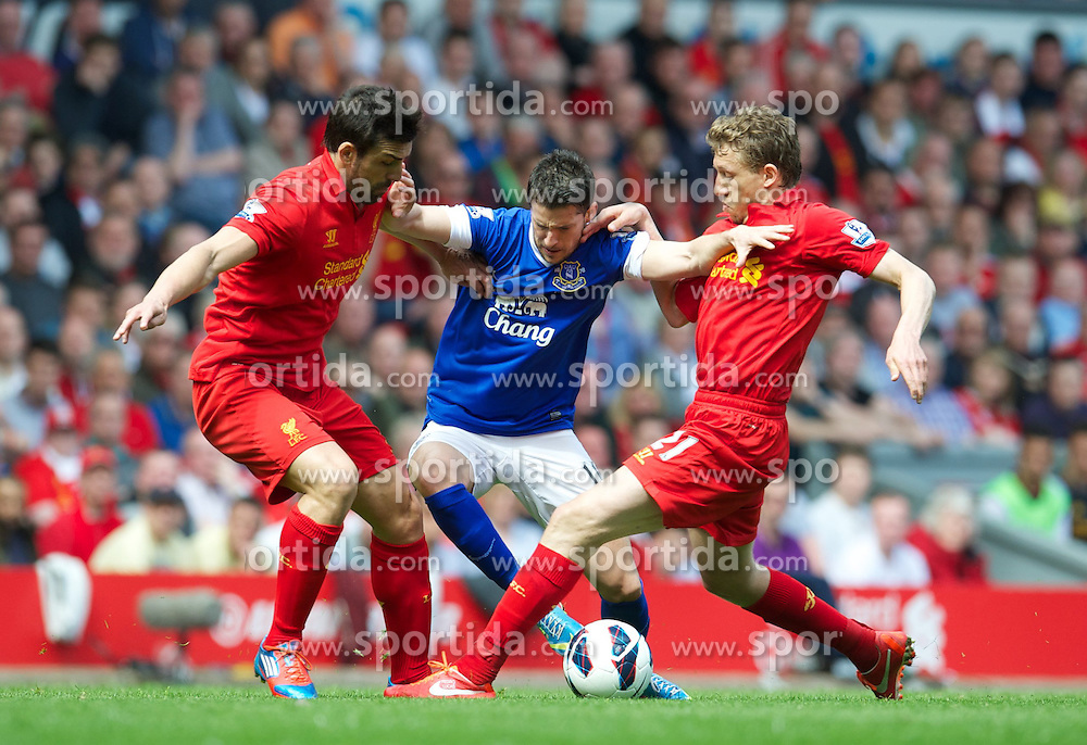 05.05.2013, Anfield, Liverpool, ENG, Premier League, FC Liverpool vs FC Everton, 36. Runde, im Bild Liverpool's Jose Enrique and Lucas Leiva tackle Everton's Kevin Mirallas during the English Premier League 36th round match between Liverpool FC and Everton FC at Anfield, Liverpool, Great Britain on 2013/05/05. EXPA Pictures © 2013, PhotoCredit: EXPA/ Propagandaphoto/ David Rawcliffe..***** ATTENTION - OUT OF ENG, GBR, UK *****