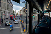 Traffic drives northwards up Southampton Row, seen from above on the top deck of a London bus as it turns right into Theobolds Road in Holborn, on 5th November 2019, in London, England.