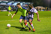 Havant & Waterlooville defender Dan Strugnell tussles with Maidenhead United midfielder James Akintunde during the Vanarama National League match between Maidenhead United and Havant & Waterlooville FC at York Road, Maidenhead, United Kingdom on 26 March 2019.