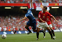 Picture: Henry Browne.Digitalsport<br /> Date: 08/08/2004.<br /> Arsenal v Manchester United FA Community Shield.<br /> <br /> Jose Reyes is taken out by United's Gary Neville.