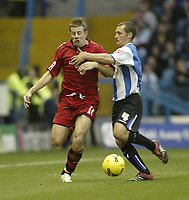 Photo: Aidan Ellis.<br /> Sheffield Wednesday v Cardiff City. Coca Cola Championship. 25/11/2006.<br /> Cardiff's Paul Parry is fouled by Wednesday's Kenny Lunt