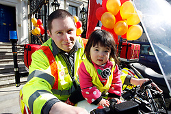 Repro Free: 02/04/2013 Pictured at the launch of Blood Bike East is Ciara Kiely (2) from Huntstown with her father Gordon one of the volunteer riders. Blood Bike East is a charitable organisation that delivers blood & medical products by motorbike between hospitals in Leinster free of charge. It is an entirely volunteer run organisation and Blood Bike East riders are highly trained and can safely negotiate traffic where large vehicles would be unable to do so, unless an emergency blue light vehicle is taken off an already overstretched service. DoneDeal's recent donation of ?32,309 facilitated the purchase of additional motorcycles and their maintenance which was key to today's launch that sees the service roll out across all of Leinster. Pic Andres Poveda