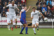 Swansea City midfielder Daniel James (20) takes on Ipswich Town defender Matt Pennington (5) during the EFL Sky Bet Championship match between Swansea City and Ipswich Town at the Liberty Stadium, Swansea, Wales on 6 October 2018.
