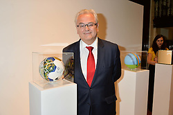 The Brazilian Ambassador to the UK ROBERTO JAGUARIBE at the Art of Futebol - a charity auction of 11 footballs signed by 11 Brazilian legends from Pele to Neymar & decorated and designed by 11 leading contemporary artists in aid of Action for Brazil's Children Trust held at the Brazilian Embassy, 16 Cockspur Street, London on 10th July 2014.