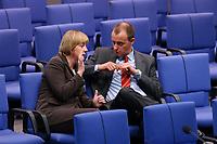 04 JUL 2002, BERLIN/GERMANY:<br /> Angela Merkel, CDU Bundesvorsitzende, und friedrich Merz, CDu, CDU/CSU Fraktionsvorsitzender, im Gespraech, Bundestagsdebatte zur Lage der Wirtschaft in Deutschland, Plenum, Deutscher Bundestag<br /> IMAGE: 20020704-01-063<br /> KEYWORDS: Gespr&auml;ch