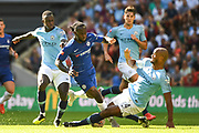 Chelsea Defender Victor Moses (15) gets tackled by Manchester City Defender Vincent Kompany (4) during the FA Community Shield match between Chelsea and Manchester City at Wembley Stadium, London, England on 5 August 2018. Picture by Stephen Wright.