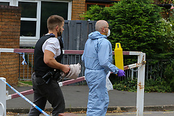 © Licensed to London News Pictures. 04/07/2020. London, UK. A forensic officer with evidence markers on Roman Way, Islington in north London as police launch a murder investigation following fatal shooting. Police were called at at 3.20pm to Roman Way, following reports of shots fired.  Officers attended with LAS and found a man, believed to be aged in his early 20s, suffering from gunshot injuries. Despite their best efforts, he was pronounced dead at the scene. Photo credit: Dinendra Haria/LNP
