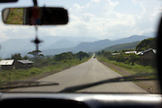 Mountains in the distance looking through the front windscreen of a car, Ethiopia