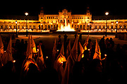 Nazarenos process in front of the Plaza de España as part of Holy Week on March 24. 2013 in Seville, Spain.