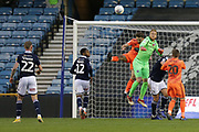Millwall goalkeeper Ben Amos (13) makes a rare save, watched by Millwall defender Mahlon Romeo (12) and Millwall striker Aiden O'Brien (22) during the EFL Sky Bet Championship match between Millwall and Ipswich Town at The Den, London, England on 27 October 2018.