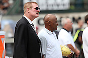 Former Oakland Raiders players (L-R) Ted Hendricks, also known during his playing days as the Mad Stork, and Cliff Branch look on from the sideline during the 2015 NFL week 1 regular season football game against the Cincinnati Bengals on Sunday, Sept. 13, 2015 in Oakland, Calif. The Bengals won the game 33-13. (©Paul Anthony Spinelli)
