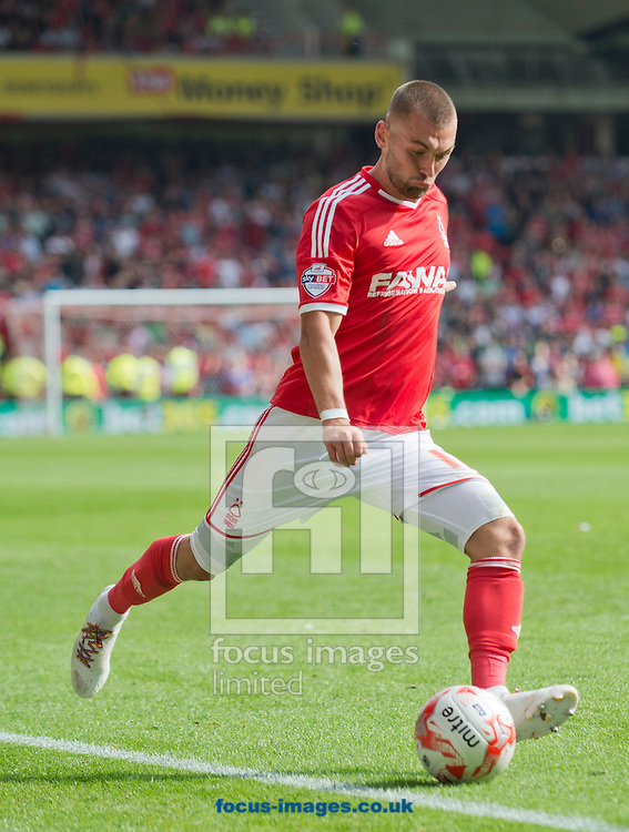Jack Hunt of Nottingham Forest puts in a cross during the Sky Bet Championship match at the City Ground, Nottingham<br /> Picture by Russell Hart/Focus Images Ltd 07791 688 420<br /> 14/09/2014