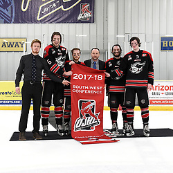 TORONTO, ON  - APR 10,  2018: Ontario Junior Hockey League, South West Conference Championship Series. Game seven of the best of seven series between Georgetown Raiders and the Toronto Patriots. OJHL Commissioner Marty Savoy present the South West Conference Championship banner to the Georgetown Raiders Team Captains. <br /> (Photo by Andy Corneau / OJHL Images)