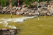Discoloration of the Animas River is evident at Santa Rita Park, a popular recreation site for local boaters, in Durango, Colorado. This section of the river is designated as a whitewater park and kayaker slalom course.