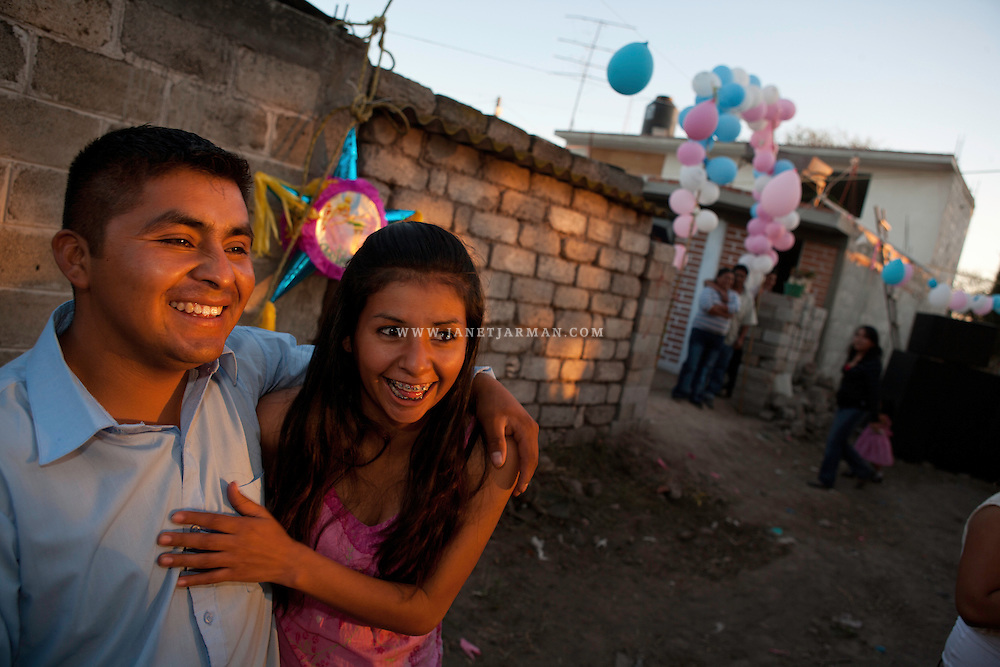 Hidalgo, Mexico, 2008 - Marisol and Andrés enjoy the baptism event they threw for over 200 villagers in Andrés' hometown. Even though they had no savings, they scraped together around $700 for the party, since it was important to him to show his success to his community.