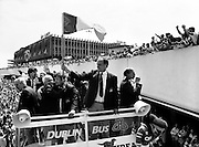 Assistant Manager Maurice Setters waves the Tricolour to a delighted crowd as the bus sets off for Dublin city centre.<br />