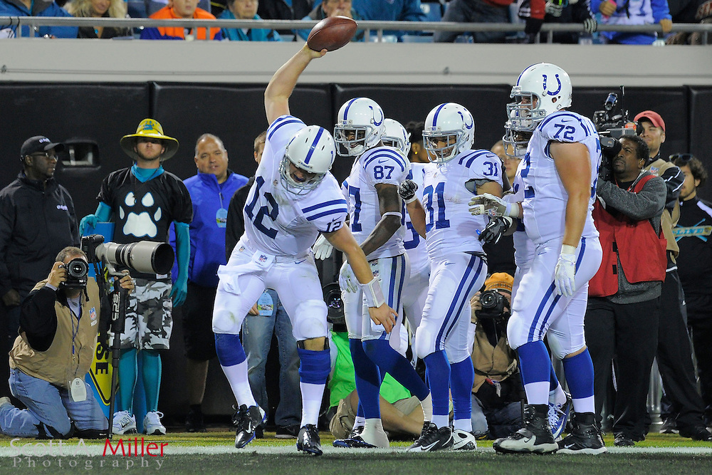 Indianapolis Colts quarterback Andrew Luck (12) celebrates scoring a touchdown during the Colts 27-10 win over the Jacksonville Jaguars at EverBank Field on November 8, 2012 in Jacksonville, Florida. ..©2012 Scott A. Miller..