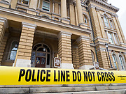 "16 MARCH 2020 - DES MOINES, IOWA: Police tape at the south stairs of the Iowa State Capitol in Des Moines to prevent people from going into the building. Because of numerous reports of Coronavirus in Iowa, the governor is suspending the legislative session for 30 days. It was scheduled to run until mid-April. Sunday night, the Governor announced that the state health department had recorded ""community spread"" in Des Moines. As a result the State Capitol instituted mitigation measures that included mandatory health screening for everyone going into the building, canceling group tours of the building, and closing the souvenir shop and snack bar.      PHOTO BY JACK KURTZ"