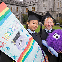 "FREE IMAGE- NO REPRO FEE. Launching the Professor Fluffy ""Design a Bookmark Competition 2017"" in University College Cork are the inaugural winners, Lauren Osagie and Ewelina Szewczyk, representing North Presentation Primary School with their bookmark and Professor Fluffy from UCC PLUS+. The competiton is aimed to encourage DEIS schools to get involved in College Awareness Week (20th – 26th November 2017). Photo By Tomas Tyner, UCC."