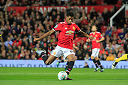 Manchester United striker Marcus Rashford (19) scores his first goal of the night (1-0) during the EFL Cup match between Manchester United and Burton Albion at Old Trafford, Manchester, England on 19 September 2017. Photo by Richard Holmes.