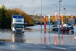 South Yorkshire flooding. Ickles Roundabout Rotherham. Lorry driver Stranded in his vehicle shortly before the arrival  Specialist rescue teams from the West Midlands Fire service rescue people from vehicles and business premises along the A6178<br /> <br />  Copyright Paul David Drabble<br />  07 November 2019<br />  www.pauldaviddrabble.co.uk