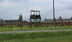 A guard tower and barracks at the Auschwitz-Birkenau Nazi concentration camps in Auschwitz, Poland on September 3, 2017. Auschwitz concentration camp was a network of German Nazi concentration camps and extermination camps built and operated by the Third Reich in Polish areas annexed by Nazi Germany during WWII. It consisted of Auschwitz I (the original camp), Auschwitz II–Birkenau (a combination concentration/extermination camp), Auschwitz II–Monowitz (a labor camp to staff an IG Farben factory), and 45 satellite camps. In September 1941, Auschwitz II–Birkenau went on to become a major site of the Nazi Final Solution to the Jewish Question. From early 1942 until late 1944, transport trains delivered Jews to the camp's gas chambers from all over German-occupied Europe, where they were killed en masse with the pesticide Zyklon B. An estimated 1.3 million people were sent to the camp, of whom at least 1.1 million died. Around 90 percent of those killed were Jewish; approximately 1 in 6 Jews killed in the Holocaust died at the camp. Others deported to Auschwitz included 150,000 Poles, 23,000 Romani and Sinti, 15,000 Soviet prisoners of war, 400 Jehovah's Witnesses, and tens of thousands of others of diverse nationalities, including an unknown number of homosexuals. Many of those not killed in the gas chambers died of starvation, forced labor, infectious diseases, individual executions, and medical experiments. In 1947, Poland founded a museum on the site of Auschwitz I and II, and in 1979, it was named a UNESCO World Heritage Site. Photo by Somer/ABACAPRESS.COM