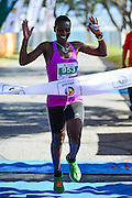 MOSSEL BAY, SOUTH AFRICA - SEPTEMBER 24: Olivia Chitate (953) of Zimbabwe wins the ladies race during the PetroSA Marathon finishing at Santos Caravan Park on September 24, 2016 in Mossel Bay, South Africa. (Photo by Roger Sedres/Gallo Images)