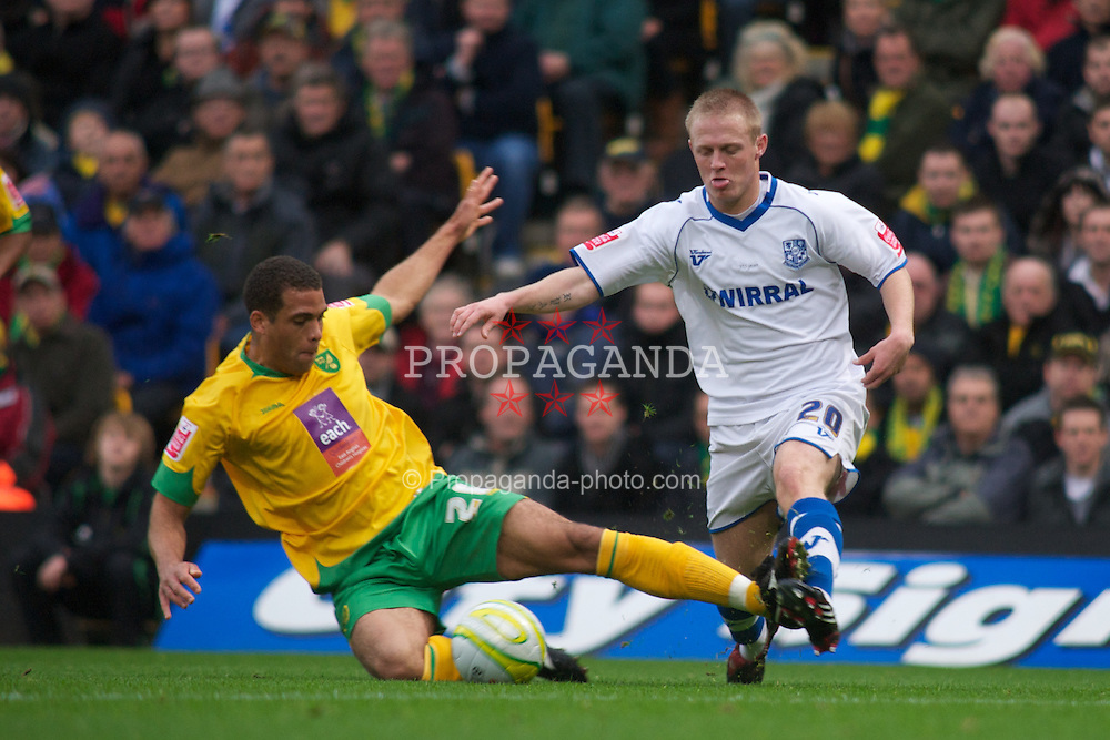 NORWICH, WALES - Saturday, November 14, 2009: Tranmere Rovers' Ryan Fraughan is stopped by the sliding foot of Norwich City's Darel Russell during the League One match at Carrow Road. (Pic by David Rawcliffe/Propaganda)