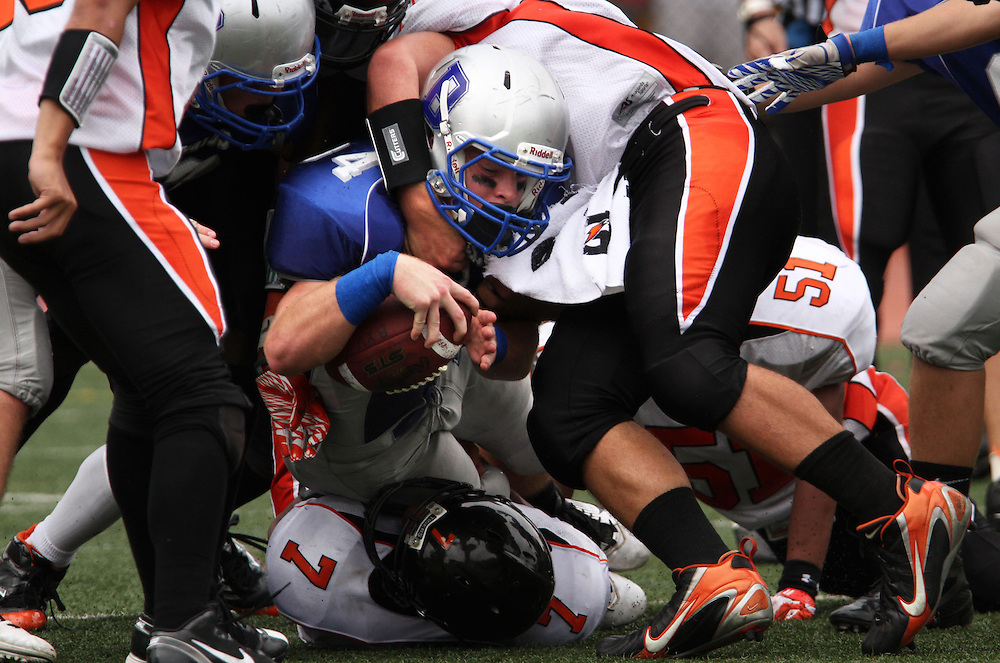 Xavier Mascareñas/The Journal News; Bronxville's Christian Conway is brought down head on by Tuckahoe's Gary Moss during the football game between the two state champs at Bronxville High School on Sept. 24, 2011. Bronxville beat Tuckahoe 33-12.
