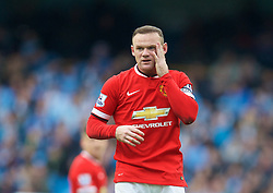 MANCHESTER, ENGLAND - Sunday, November 2, 2014: Manchester United's Wayne Rooney looks dejected as his side lose 1-0 to Manchester City during the Premier League match at the City of Manchester Stadium. (Pic by David Rawcliffe/Propaganda)