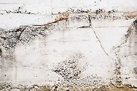 White textured exterior wall of a concrete building.