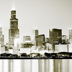 Chicago skyline at night in black and white with Willis Tower (formerly Sears Tower) one of the world's tallest buildings. Photo taken in late 2011.