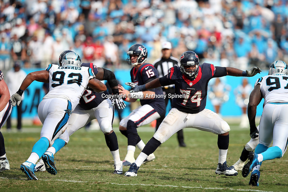 Houston Texans tackle Chris Clark (74) stretches his arms wide while Carolina Panthers defensive end Kony Ealy (94) rushes the quarterback during the 2015 NFL week 2 regular season football game against the Carolina Panthers on Sunday, Sept. 20, 2015 in Charlotte, N.C. The Panthers won the game 24-17. (©Paul Anthony Spinelli)