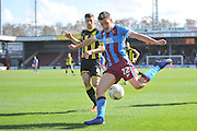 Tom Hopper of Scunthorpe United  under attack from Burton Albion midfielder John Mousinho (4)  during the Sky Bet League 1 match between Scunthorpe United and Burton Albion at Glanford Park, Scunthorpe, England on 9 April 2016. Photo by Ian Lyall.