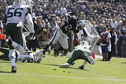 September 17, 2017 - Oakland, CA - Raiders vs. Jets.Oakland Raiders running back Marshawn Lynch (24) evades tackles and scores a TD in the 2nd quarter at Oakland Alameda County Stadium on Sunday, Sept. 17, 2017 in Oakland, CA (Credit Image: © Paul Kuroda via ZUMA Wire)