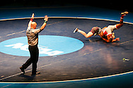 Cornell College's Trevor Engle takes on defending champ Kenneth Martin of Wartburg during the 149 pound bout at the NCAA Division III Wrestling Championship Finals at the U.S. Cellular Center in Cedar Rapids on Sat. Mar 12, 2016.  Martin won by decision 7 to 5. (Rebecca F. Miller/The Gazette)