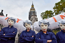 © Licensed to London News Pictures. 17/10/2017. London, UK. Public sector workers, several wearing masks depicting Theresa May, Prime Minister, as a 'MayBot' outside Parliament ahead of a rally in Parliament Square against the cap on public sector worker's' pay. Photo credit : Stephen Chung/LNP