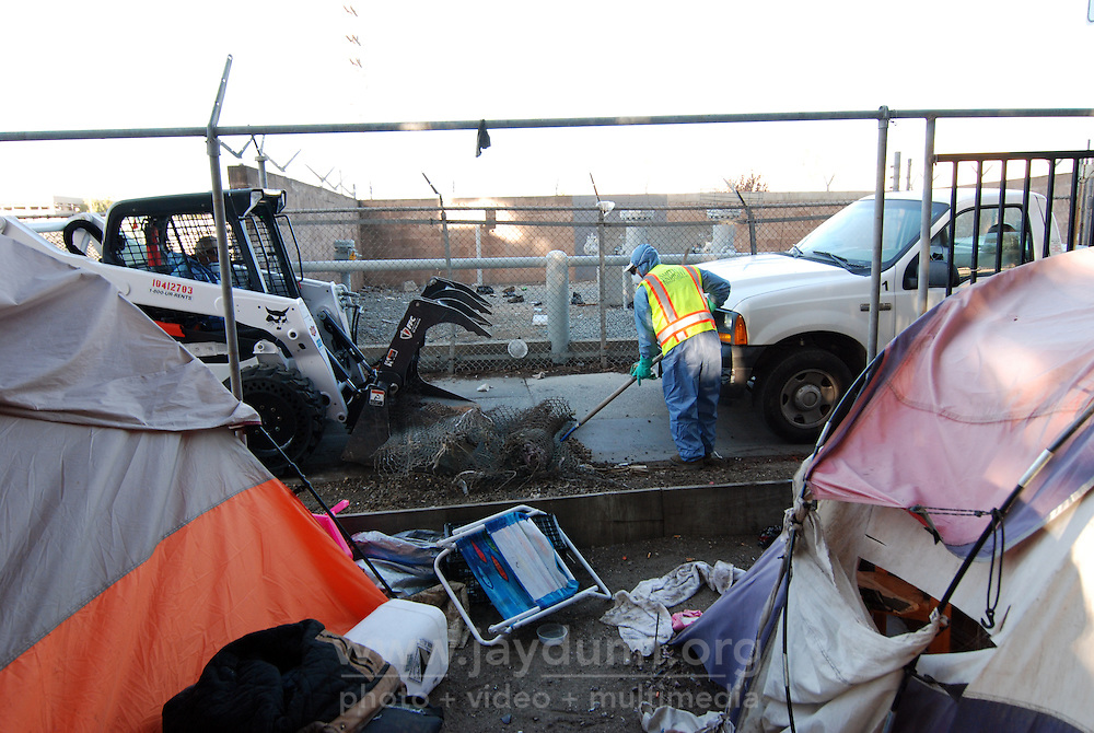 Private contractors hired by the city of Salinas clear out the possessions of homeless people residing on the property of 38 Soledad St.